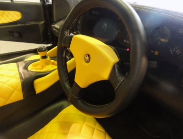 black and yellow steering wheel re-trim